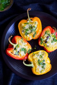 These Breakfast Stuffed Peppers are loaded with eggs, potatoes, beans, spinach and cheese!