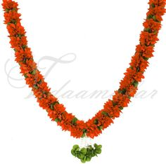 Gorgeous orange and green color artificial wedding garland  http://www.vadaamalar.com/artificial-orange-garland-4806.html