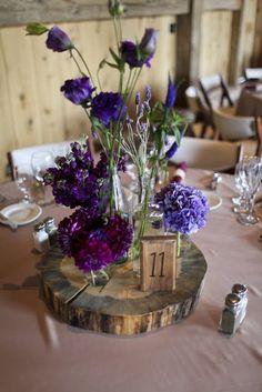wood slices + assorted glass jar vases