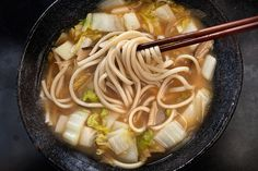 A hearty, healthy soup recipe with napa cabbage, white miso, dried shiitake mushrooms, and Japanese udon noodles.