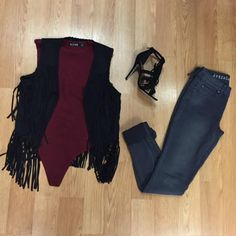 The Hella Good Fringe Vest is perfect for any time of year. Whether youthrow it over a dress or pair it with jeans, it adds a little edge to any outfit.Thisblack faux suede vest gives off a west...