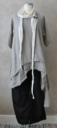 Analyze this: slim black under skirt or dress.  Soft two-layered long grey tunic.  White gauzy scarf.  Simple.