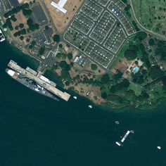 """Seventy years after a """"date which will live in infamy,"""" this satellite image of Pearl Harbor shows the symbols of a war's beginning and end. The symbol of the end is more evident: The USS Missouri sits at its dock at Ford Island in the Hawaiian harbor, s Pearl Harbor 1941, Pearl Harbor Memorial, Pearl Harbor Attack, Uss Arizona Memorial, Us Battleships, Honolulu Hi, Navy Life, Birds Eye View, Drone Photography"""