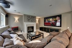 this looks awesome as a media room. Big comfy sofa and TV (although clearly I don't have anywhere near this space :) )