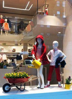 francesca signori - window display - kids spring Cute!  Idea= vintage wheel barrel with floral for spring