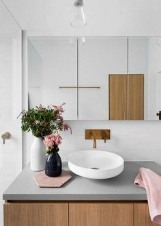 Flowers on gray minimal bathroom sink -- I love how modern this design looks + feels! Gray And White Bathroom, Grey Bathrooms, Beautiful Bathrooms, Modern Bathroom, Small Bathroom, Minimal Bathroom, Master Bathroom, Bathroom Pink, Modern Sink