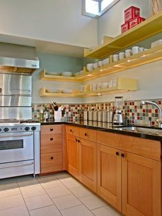 same color tiles, cabinet and counters - paint and wall tiles along with shelves looks great.