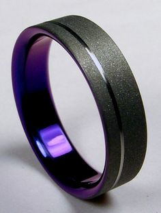 Mens #Wedding band... Burnished grey titanium on the outside, purple titanium on the inside.