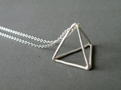 Platonic solid anyone? Pyramid Necklace Sterling Silver Triangle Pendant Necklace. Geometric Necklace Minimalist Jewelry by SteamyLab on Etsy. beautiful!