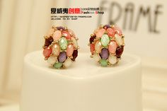 http://www.aliexpress.com/store/product/High-Quality-anti-allergic-popular-Bohemia-scrub-gem-honeycomb-stud-earrings-for-womens/239061_1401823690.html Find More Information about Brand 2014 New  Fashion  Multicolor Bohemia Gold Plated  Stud Earrings Channel for Women in Jewelry Wholesale,High Quality stud earrings for women,China earring women Suppliers, Cheap studs accessories from Hawaii Arts Jewelry