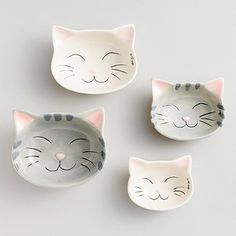 A set of smiling angel kitty measuring bowls to help you bake the purr-fect desserts. | 38 Of The Cutest Animal-Themed Products You've Ever Seen