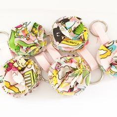 Multi colored mini fabric bloom key chain.