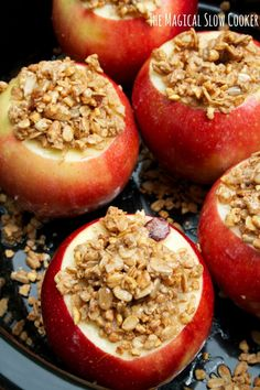 Slow Cooker Baked Apples. Apples topped with granola, then drizzled with maple syrup and butter. YUM!