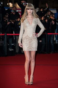 Taylor Swift rocks a short, beaded Elie Saab dress in a silhouette that works extremely well for her.