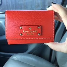 NWOT Kate Spade Red Wallet! Kate Spade red wallet. NEVER BEEN USED. Received as a graduation gift, so tags are gone. Great condition! Has a key chain ring, snap button works and as well as the zipper! kate spade Bags Wallets