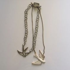 2 Bird Necklaces. 2 Bird Necklaces. 1 Bronze 1 Gold w/crystals - costume Urban Outfitters Jewelry Necklaces