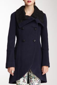 """Leather Trim Hi-Lo Wool Blend Coat in ink by Mackage $630 - $185 @HauteLook. - Contrast spread collar - Front button closure - 2 front slit side pockets - Hi-lo hem - Attached back belt - Fully lined - 31"""" shortest, 36"""" longest length Model's stats: - Height: 5'10"""" - Bust: 33""""  - Waist: 24.5"""" - Hips: 35"""" Model wearing size S. Dry clean. Shell: 70% wool, 20% polyamide, 10% cashmere. Lining: 96% polyester, 4% spandex. Trim: 100% genuine leather. Trim 2: 45% virgin wool, 30% acrylic, 25%…"""