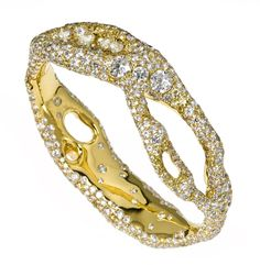 A variation of the Genesis Collection diamond bangle in yellow gold by Cindy Chao.