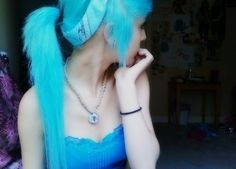 Bright blue ponytail with blue bandana