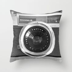 """You can finally sleep with your camera. Check out Nicklas Gustafsson's """"Camera"""" Throw Pillow, available in several indoor and outdoor sizes at Society6."""