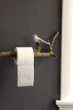 A branch for the toilet paper to hang on