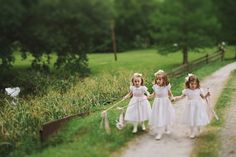 flower girls with ribbon wands and bows in their hair | Jonas Seaman Photography | Bridal Musings http://bridalmusings.com/2013/09/southern-wedding-jonas-seaman-photography/