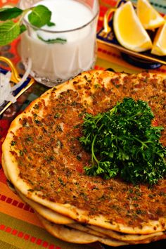 Turkish Lahmacun is usually eaten for dinner in Turkey. It is also similar to pizza but they put on different toppings that arent what you woud see in north america.