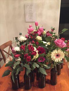I Do BBQ wedding shower - getting the centerpieces ready (beer bottle flower arrangements)