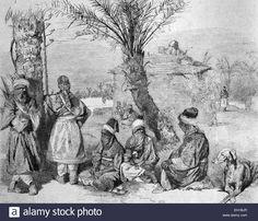 Ein Tuareg-Camp in einer Oase der Sahara, Algerien, historische Darstellung, 1877 Stockfoto Ein Tuareg-Camp in einer Oase der Sahara, Algerien, historische Darstellung, 1877