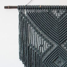 ***SALE*** 20% OFF WHEN YOU SPEND £50 OR MORE JUST USE COUPON CODE BARGAINYESPLEASE AT CHECK-OUT This original macrame wall hanging is intricately hand-knotted using 100% cotton cord (twisted, 6mm) in charcoal with a natural black moso bamboo supporting rod - definitely a statement piece! Approx Dimensions > Bamboo Width: 100cm / 39.5 inches Weaving Width: 74cm / 29 inches Length: 100cm / 39.5 inches * Please Note: this is a unique two-toned piece of bamboo - the one half is naturally black…
