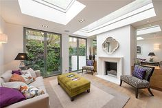 http://www.johndwood.co.uk/property-for-sale/  		An excellent example of a house that has been fully modernised and extended to an exacting standard. The dividing wall with the fireplace is a great idea! You'll find it in #Chelsea #SW3 #Londonproperty