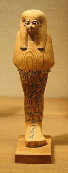 An Egyptian New Kingdom Cedar Wood Ushabti of Yuya cedar wood and ink, New Kingdom,Dynasty  XVIII. Reign of Amenothep  III, c. 1390-1352 BCE.