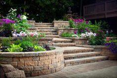 Celtik retaining walls create an ideal venue for adding color to a backyard.