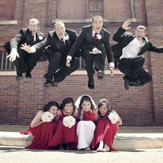 AHHHHH! This photo presents so much of exactly what our wedding day will entail...from the red bridesmaid dresses, the rose bouquets, up to the excitement and fun of the groomsmen jumping and also the amazing photo that captures it all! Our photographers will definitely earn their pay capturing the nonstop excitement that will make our special day unique and full of love  fun!