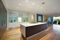 A stylishly rendered contemporary family home includes this superbly appointed Stone & Miele kitchen