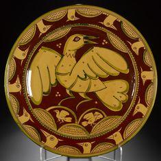 Bird Plate, of wood-fired Fremington earthenware with a lead glaze and a sgraffito bird: Scottish, Jason Shackleton, 1983.