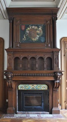 Neo-renaissance monumental oak wood fireplace with painting on canvas depicting Joan of Arc