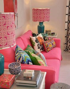 cushions on fuchsia sofa