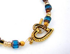 Dark Teal and Amber Bracelet with Heart by desertshinejewelry, $10.00