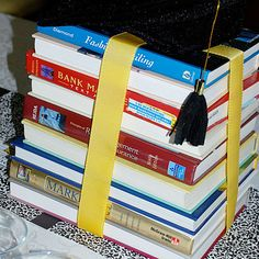 College or High School Graduation Party Centerpiece: textbooks tied with ribbon!