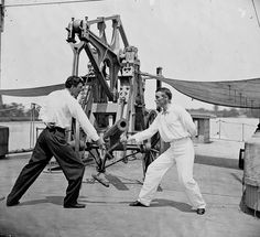 Portrait of Two Union Navy Sailors Fencing on the Deck of the Union Gunboat USS Hunchback During the Civil War