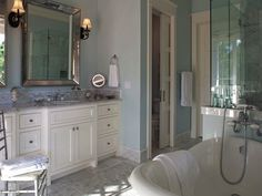 Luxurious+master+bathroom+with+blue+walls+and+water+closet+with+white+pocket+door.