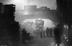 Fog encases workers at Ludgate Circus, London. It was reported that Londoners compared the effects of winter fogs to being blind as they could often only see a few yards ahead. November 1922. Getty Images