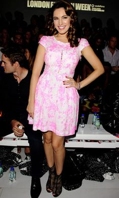 Playing it girly, Kelly Brook worked a pink prom dress and lace shoe boots at Issa.
