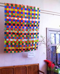 Giant painted paper strip weaving by kids