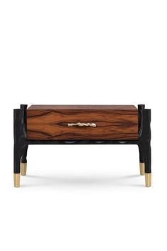 LANKA bedside table is inspired in a traditional method practiced in Sri Lanka, the stilt fishing, now disappearing. The vertical poles embeded into the sea floor are the main reference for the structure of LANKA: in matte black lacquer, it supports the main body covered in matte palisander wood veneer, and with matte brass details. This bedside table is an elegant choice for a bedroom in a residential or hotel project.