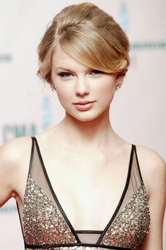 Taylor Swift's Beauty Transformation - 2008: For the 42nd Annual CMA Awards Swift goes for a bouffant-inspired updo.