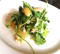 At The Little Owl, NYC...... the delightfully light and flavorful salad of artichoke heart, hearts of palm, crushed green olives and grapefruit supremes tossed with arugula ($13), that salad alone is worth the trip. (Supremes are the naked flesh of the fruit with no rind, pith or seeds.)