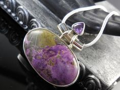 """Made with Variscite in Purpurite cabochon and amethyst gemstone with sterling silver. Comes with complimentary 18"""" sterling silver plated 2mm snake chain with lobster clasp."""