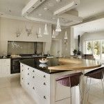 Lighting and silver accents in this custom-made kitchen we designed and created ...